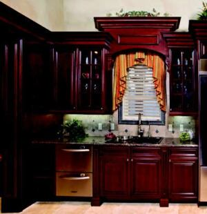 CABINET MEMBERS: The kitchen is outfitted with cabinetry by Canac Kitchens -- Virginian maple Hazelnut with black antiquing for the main storage and Virginian maple Riverstone with chocolate glazing on the island.  Both styles feature full-access boxes, concealed hinges, and solid wood drawers with dovetail construction.  www.canackitchens.com