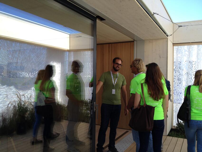 Team Austria shows off LISI House to visitors; the sliding glass doors are one of its most expensive features.