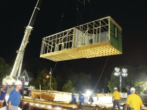 "NIGHT MOVES: One of 11 modules being set for an ""Extreme Makeover: Home Edition"" project that had more than its share of challenges."