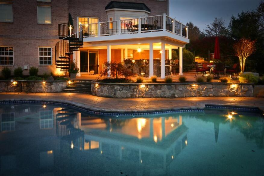 The best time to take a deck photo is in the early evening, as the light changes from daylight to twilight, especially if the project is highlighted by dramatic landscape lighting.