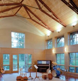 "cutting-edge wedge  Carney strives to create architecture that's appropriate to his Wyoming locale and to his firm's modern aesthetic. One way to ease the stylistic tension is to apply a contemporary twist to tried-and-true elements such as trusses, as he did with the ones in his home studio. Carney chose Belfer's halogen wedge to show off these raffish rafters. Speced in black, the fixture is delightfully discreet. ""It's a little triangle that lights the ceiling beautifully,"" he says. Belfer, 732.493.2666; www.belfer.com"