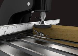 This cutaway shot shows how the bit comes up through the table when the lever is pulled.