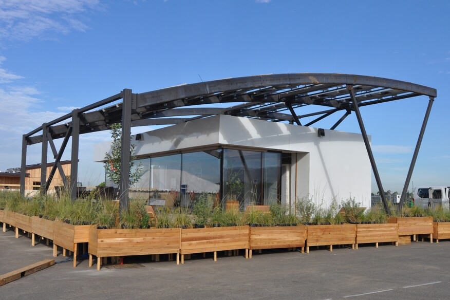 Team West Virginia/Rome entered STILE House (Sustainable Technologies Integrated in a Learning Experience) to the 2015 Solar Decathlon, with photovoltaic panels arranged on a steel arched canopy that shades the living quarters below it.