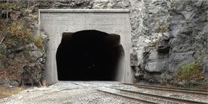 Squaring the rounded corners on some tunnels created enough extra height for double-stacked trains.