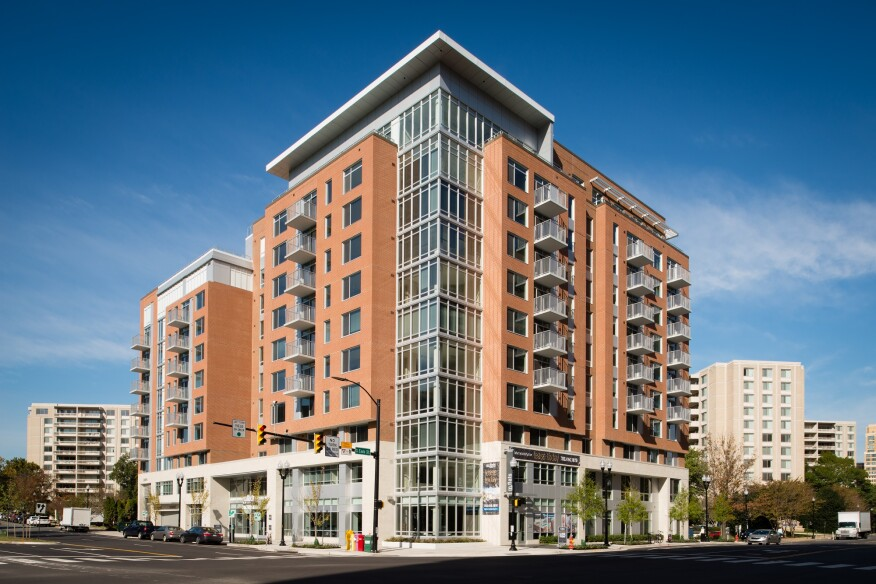 How do you differentiate a new residential building? Kettler's m.flats in Crystal City does it with sustainable materials used creatively, such as locally sourced brick, metal paneling, metal balcony rails, glass-bay projecting towers, and a two-story limestone base.