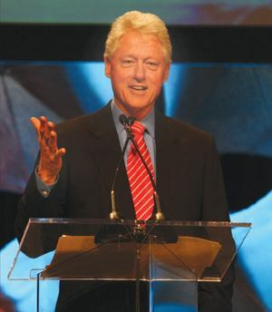 """Former President Bill Clinton explained the Clinton Climate Initiative's partnerships  and efforts to """"Show the world that the solution to the climate  crisis is not far in the future."""""""