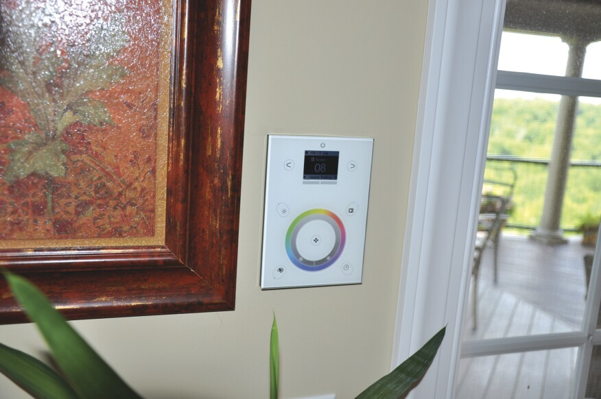 The basement panel is connected to a touch-screen DMX controller mounted in the living room.