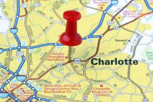 Fast Facts Charlotte, N.C.  Population:716,874  Occupancy: 88%  Median age: 37  Median Household Income: $48,670  Average Rent: $725  Unemployment: 8.9%  Notable: Charlotte is one of the largest financial centers in the nation, second only to New York. More than 300 of the Fortune 500 businesses have an office in Charlotte. Plus, more than 60 percent of the U.S. population lives within a two-hour flight of Charlotte. The city was also selected as the new home for the NASCAR Hall of Fame.