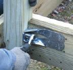 Several manufacturers produce hardware designed to withstand the loads imposed by railing posts. Shown here is a Simpson Strong-Tie DTT2.