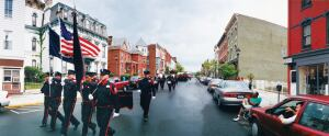 Firefighters parade through Hudson, N.Y., in 2001.