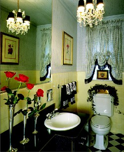 Chandeliers are perfect for powder rooms. Designer Geraldine Kaupp suggests centering the fixture in high-ceilinged rooms.