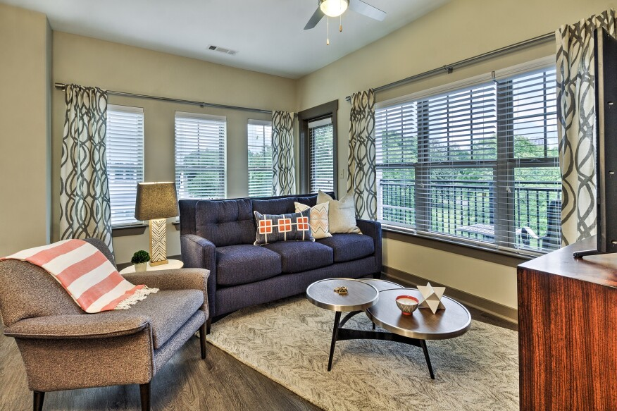 The units at Cedar Flats range from 674-square-foot one-bedrooms to 1,214-square-foot two-bedrooms and feature  open-style living areas and easy-care vinyl-plank floors.