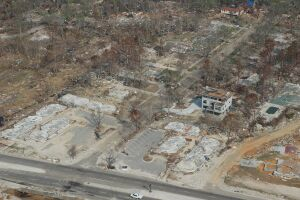 """An elevated concrete home under construction is the only building left standing among """"slabbed"""" conventional homes in this aerial photo taken after Hurricane Katrina in Pass Christian, Ms."""