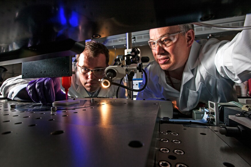 Using an additive manufacturing process called direct ink writing, Lawrence Livermore National Laboratory (LLNL) engineers Eric Duoss (left) and Tom Wilson create an engineered-foam cushion.