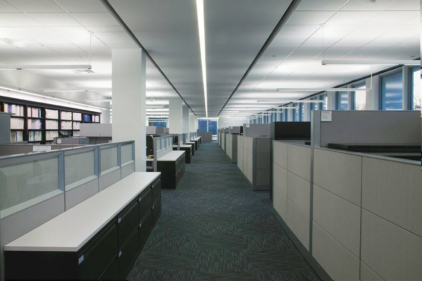 """Upper-level open office area. The """"lines of light"""" motif is carried through the fixture treatments in the ceiling."""