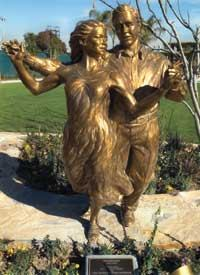"SHALL WE DANCE?: Colorado-based artist Gary Alsum created ""Promenade,"" a bronze statue on the grounds of the affordable Little Lake Village at Santa Fe Springs."