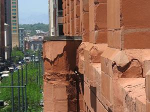Stone and flashing showing wear on the Brown Palace Hotel.