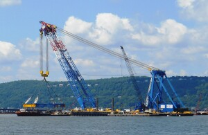 The I Lift NY super crane (seen in June 2015) represents a financial saving to New York State as it helps crews build the new bridge and will help dismantle the current bridge sometime during 2017.