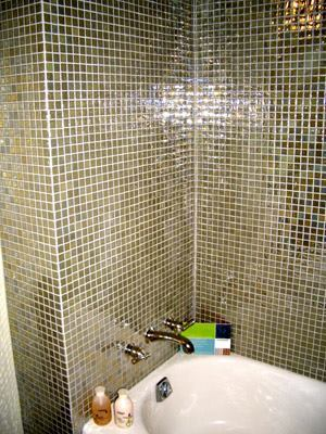 Sound Surround: Modwalls tile in Viridian Pearl Mint was used for the tub surround. The tile is made with 98% pre-consumer recycled glass.