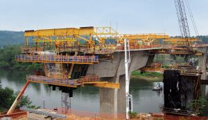 Structural concrete bridge constructions, such as this castin- place segmental bridge, are gaining popularity with DOTs as a way to build bridges.