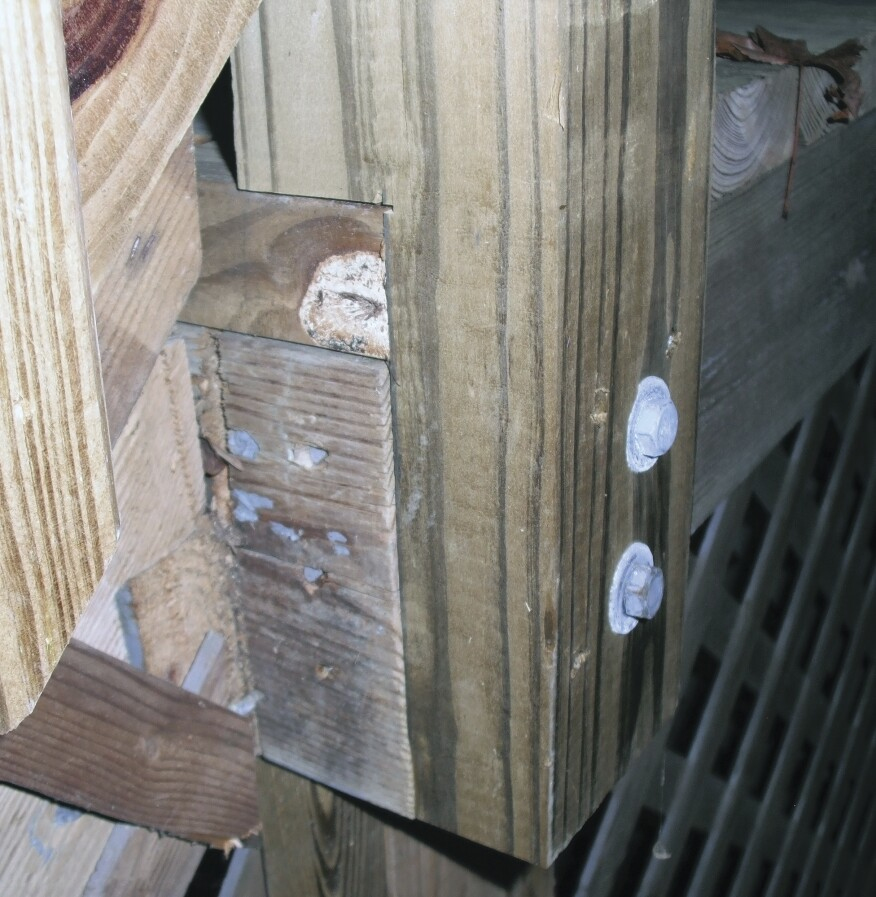 Guard posts that have been notched around the framing may develop cracks originating  in the corner of the notch and running parallel to the grain. Notching weakens a post, and should be avoided.