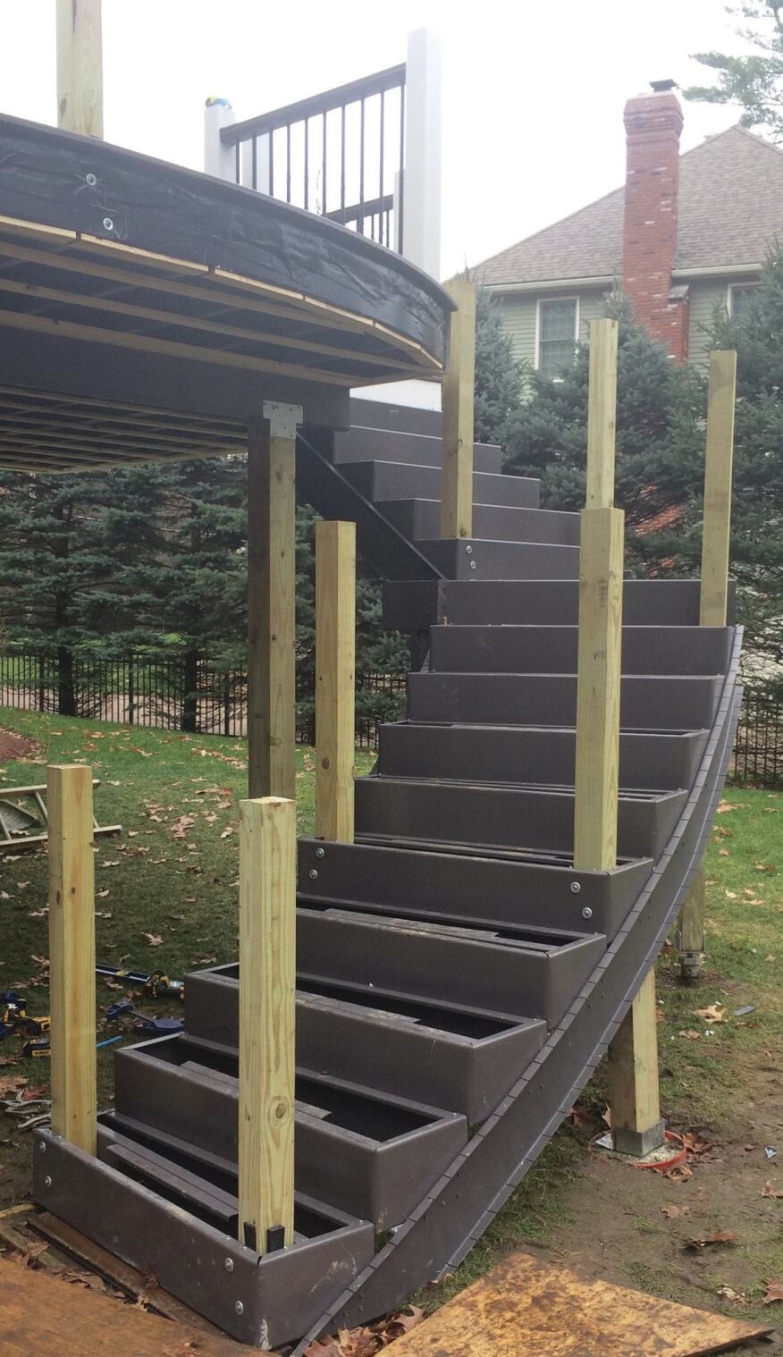 The lower run of stairs curves to match the curve of the deck. The stringer tracks needed to be kerfed so that they could be bent to the proper radius.