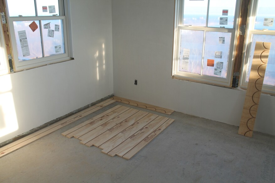 After the reference lines are snapped, single panels are installed along one wall as a guide. Special return panels line up with grooves in the straight panels.