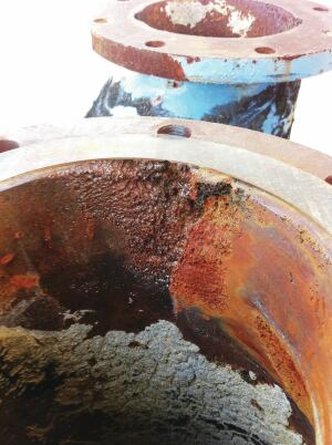 Cavitation erodes coatings on valves and pipe, creating a porous, pock-marked surface.
