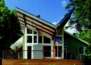 The home began as a simple 1920s bungalow, and though its facade retains its  Craftsman simplicity, the rear is dramatically contemporary, culminating in a butterfly roof.