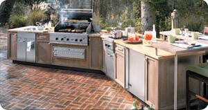 With the grill as the center of attention, plan plenty of prep and dining space into an outdoor kitchen layout so the griller and guests can enjoy the space.