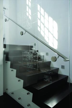 The crew found original blueprints from a 1930s remodel behind the walls. To highlight the history of the house, architect Bjorn Skaptason had a local specialty firm etch the plans into the glass wall by the staircase.