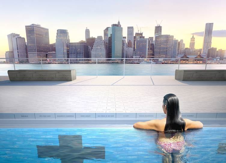 The pool's partition will protect the swimmers from the river, yet still allowing them to see the city's skyline.