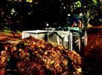 A Portland, Ore., worker pushes leaves to the end of a city block for pick-up. Leaves are then are moved to the recycling facility by dump truck.