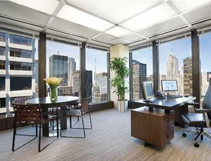 The CEO's office, located in the southwest corner of the building, receives a steady stream of afternoon light from the floor-to-ceiling windows.