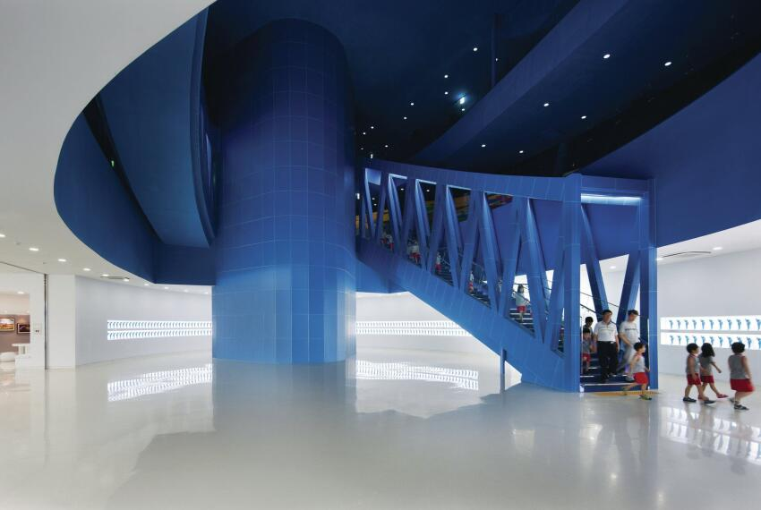 After making their way through the immersive multimedia galleries, visitors venture down the final trussed staircase and into brighter exhibition galleries on the first floor.