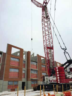 Hollowcore plank manufactured by Oldcastle Precast Building Systems is erected at Prospect Plaza.