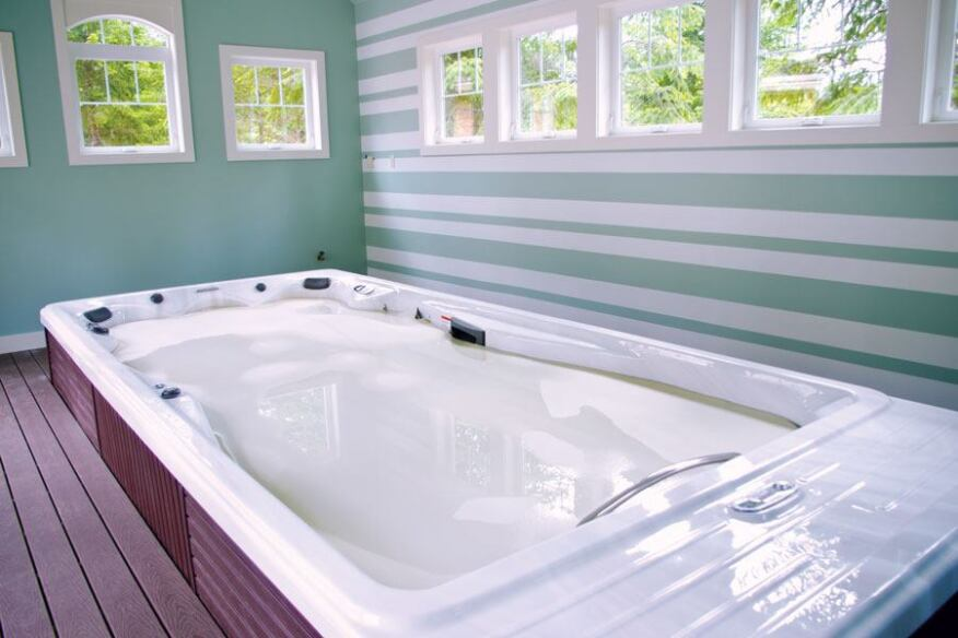 Swim spas are becoming a popular feature in exercise rooms. This one features an insulated floating cover. Notice how it is partially recessed into the floor.