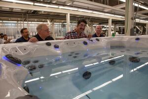 Michael Phelps tours the Master Spas factory to view production of the Michael Phelps Signature Swim Spa.