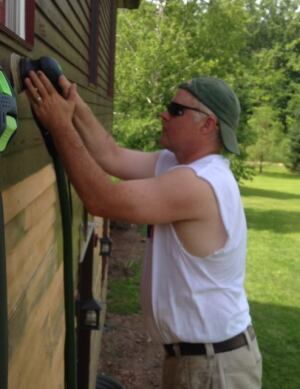 The author on an exterior paint removal project in 2014.