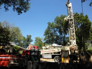 Installing the geothermal system for the KellyGreen house involved squeezing the drilling equipment onto the tiny lot, including navigating a front slope.