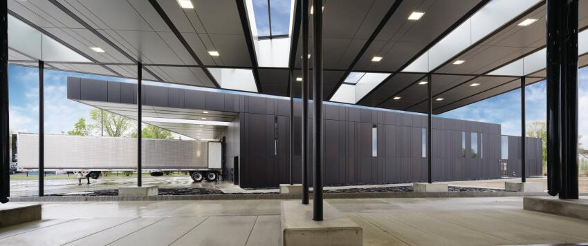 A truck moves through the commercial traffic checkpoint under the canopy at the new U.S. Land Port of Entry in Van Buren, Maine.