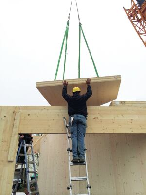 To maneuver floor panels into position, the crew attached the crane cables to threaded  hardware embedded in the face of the panels.