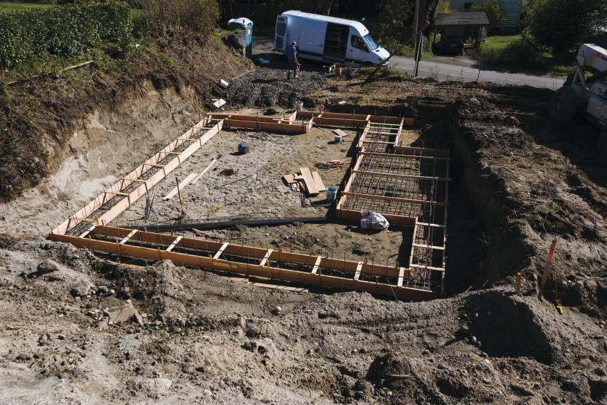 Each run was a custom width and depth, and one area of the footings was poured as a structural slab.