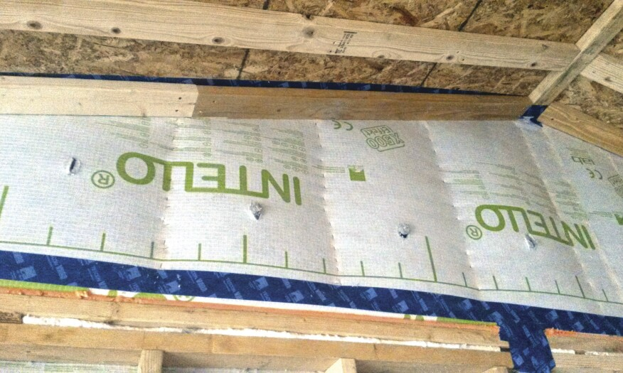 Intello smart vapor retarder fabric was wrapped up the gable wall.