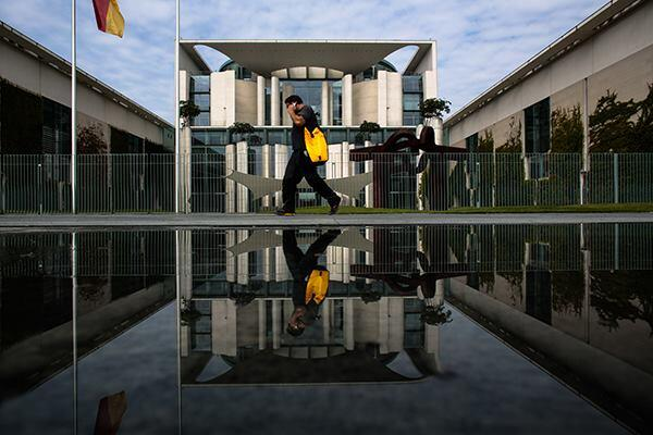 A man walks past the federal chancellery in Berlin on June 4. The 2001 building was designed by Berlin-based Schultes Frank Architekten.