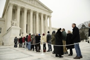 People line up outside the U.S. Supreme Court building shortly after the casket of late Supreme Court Justice Antonin Scalia arrived at the court to lie in repose in Washington Feb. 19.  REUTERS/Gary Cameron