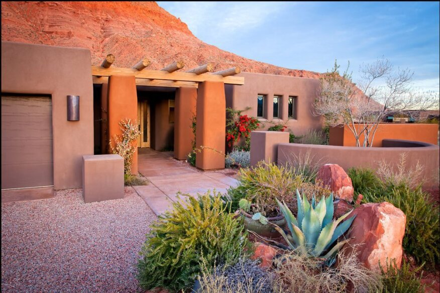 Utah-based J2 Builders revegetates its building sites with plants such as yucca, cactus, agave, and sand sage, low-maintenance natives that help the house meet the ground gracefully.