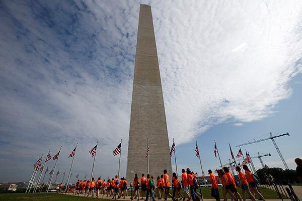 Students in front of the Washington Monument on May 12. (AP Photo)