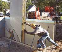 Pre-insulated to achieve even greater thermal benefits, precast wall panels can be set by crane with only a few trained workers in perhaps a third the time of a conventional wood frame.