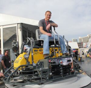 Darin Wiebe, winner of Wacker Neuson's 2012 Trowel Challenge competition at the World of Concrete, celebrates his victory on a new customized CRT 48-35VX ride-on trowel powered by a special VanguardTM BIG BLOCKTM V-twin engine. Wiebe is owner-financial manager of Extreme Concrete, Inc., Linden, Alberta Canada. Besides winning the trowel for his company, he also receives a one-week trip to the Caribbean for himself and a guest.